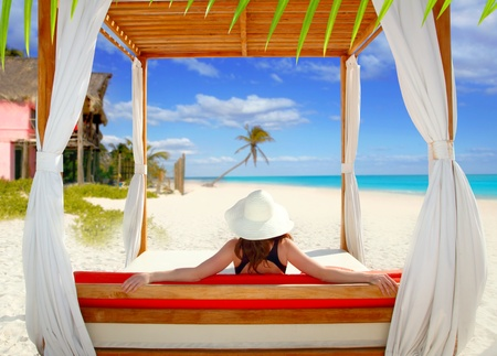 gazebo tropical beach woman rear view looking sea tropical resort photo