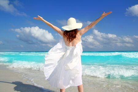 beach rear woman wind shaking white dress tropical turquoise Caribbean photo