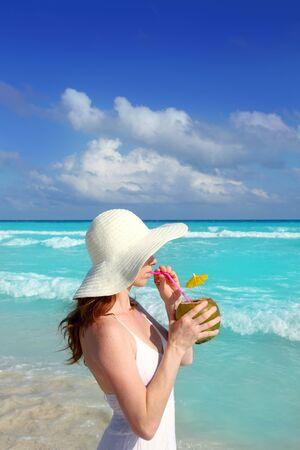 coconut fresh cocktail profile beach woman drinking tropical Caribbean photo