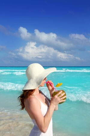 coconut fresh cocktail profile beach woman drinking tropical Caribbean photo