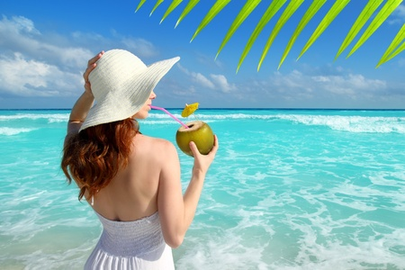 woman beach dress: coconut fresh cocktail profile beach woman drinking tropical Caribbean Stock Photo