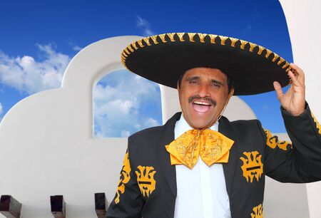 Charro mariachi portrait singing shout in mexican houses background photo
