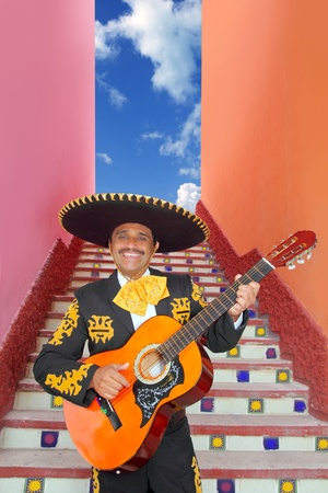 Charro Mariachi singer playing guitar in Mexico stairway photo