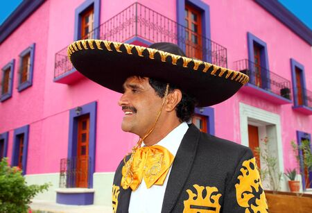 Charro mexican Mariachi portrait in pink Mexico house photo