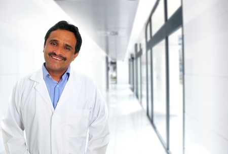 Indian latin doctor expertise smiling in hospital corridor photo