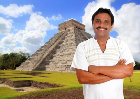 Mexican man with mayan shirt smiling in Chichen Itza pyramid photo