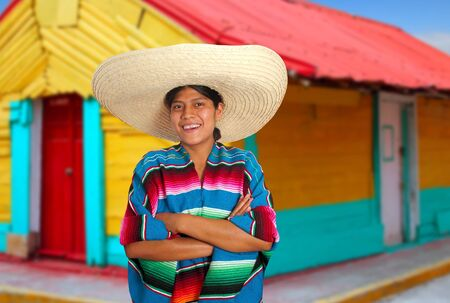 Latin mexican hispanic sombrero poncho woman colorful Mexico houses Stock Photo - 9410659
