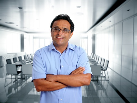 casual meeting: indian latin businessman glasses blue shirt in boardroom office