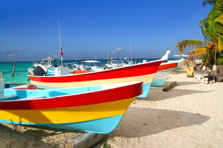 roo: colorful tropical boats beached in the sand Isla Mujeres Mexico