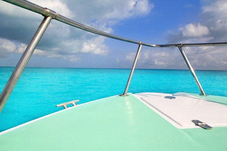 boat green bow in turquoise caribbean sea seascape photo