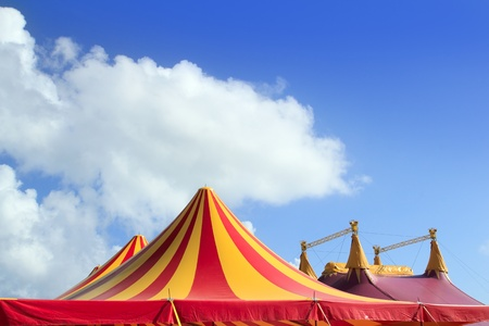 fairground: Circus tent red orange and yellow stripped pattern blue sky
