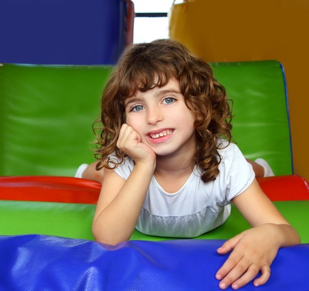 brunette little girl portrait posing in playground colorful Stock Photo - 9416897