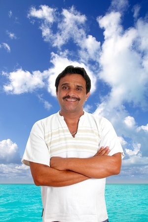 Mexican man with mayan shirt smiling in tropical beach vacation photo