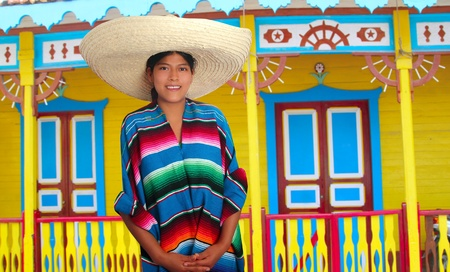 Latin mexican hispanic sombrero poncho woman colorful Mexico houses photo