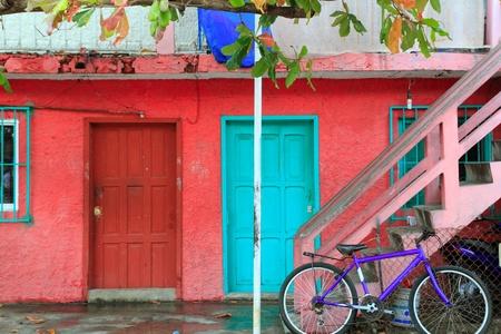 isla: colorful Caribbean houses tropical vivid colors Isla Mujeres Mexico Stock Photo