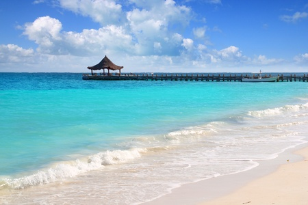 mayan: Caribbean sea truquoise beach pier hut Mayan Riviera Puerto Morelos Mexico Stock Photo