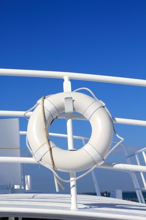 boat buoy white hanged in railing summer vacation blue sky photo