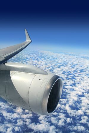airplane wing aircraft turbine flying blue sky white clouds photo