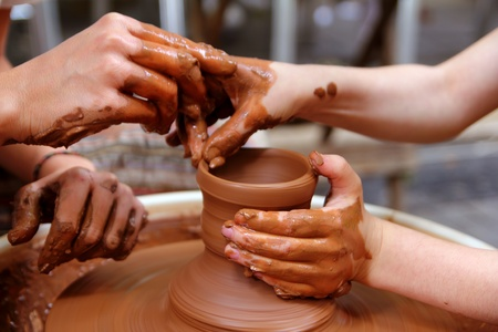 potters wheel: clay potter hands wheel pottery work workshop teacher and pupil