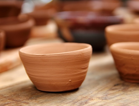 stoneware: clay crafts pottery studio wood table traditional potter work warm color