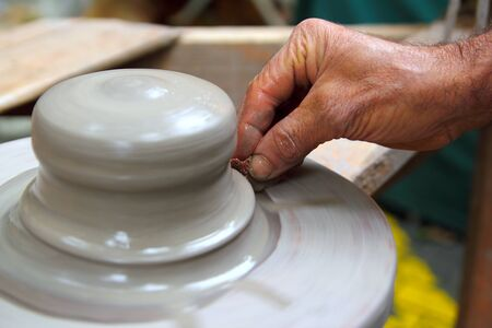stoneware: man potter hands working on pottery clay wheel stoneware sponge