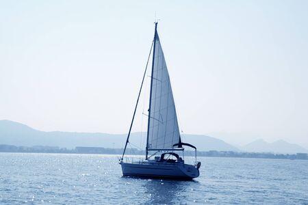 sailboat sailing in blue mediterranean sea mountain horizon Denia Spain Stock Photo - 9494259