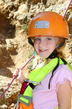 rappel: climbing little girl portrait helmet rope safety harness smiling Stock Photo