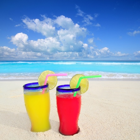 beach cocktails yellow red in caribbean tropical turquoise sea sand photo