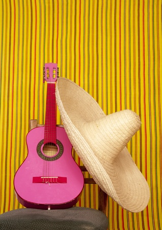 charro mexican hat pink guitar in striped background photo