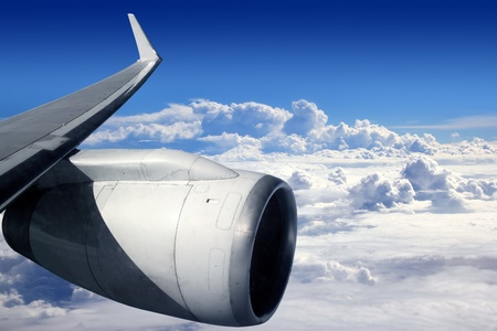 light aircraft: airplane wing aircraft turbine flying blue sky white clouds
