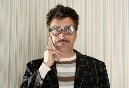 dork: crazy nerd man myopic thinking gesture expression funny glasses man Stock Photo