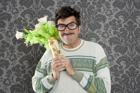 myopic: anger funny man violent threat expression with flowers vase Stock Photo