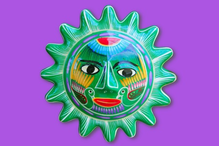 Mexican indian sun handcraft ceramic isolated in purple background photo