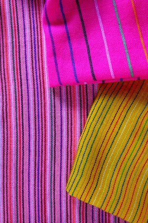artisanry: Mexican serape vibrant colorful macro fabric texture background Stock Photo