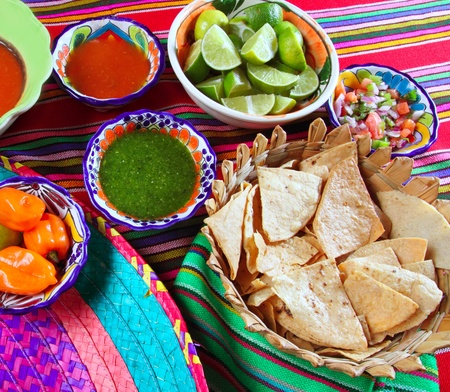 serape: Mexican food varied chili sauces nachos lemon Mexico flavor Stock Photo