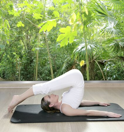 dense mats: black mat yoga woman window view of rainforest jungle tropical Stock Photo
