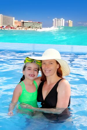 mother and daughter hug in pool tropical beach Caribbean background photo