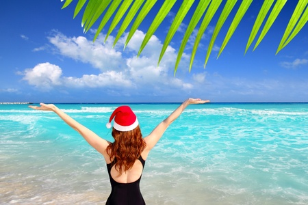 american woman tourist christmas caribbean vacation santa hat photo
