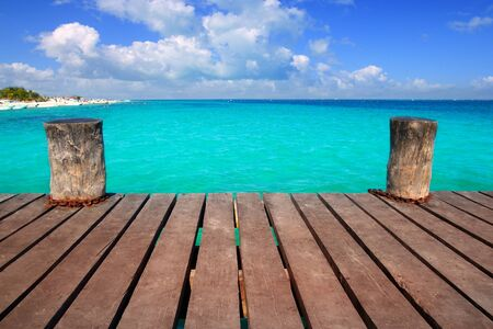 mayan riviera: Caribbean wood pier with turquoise aqua sea blue sky Mayan Riviera Stock Photo