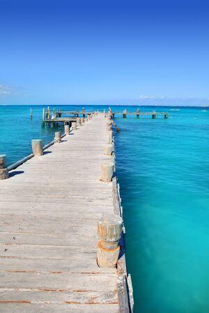 Cancun wood pier in  tropical Caribbean beach photo