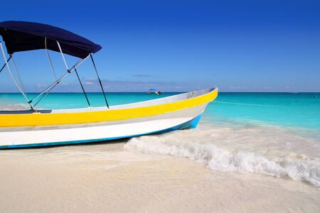 boat tropical beach Caribbean turquoise sea water photo