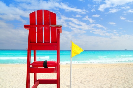 baywatch: Baywatch red beach seat yellow wind flag in tropical caribbean sea