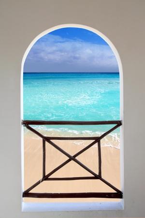 through the window: arch balcony white window tropical Caribbean beach seen through
