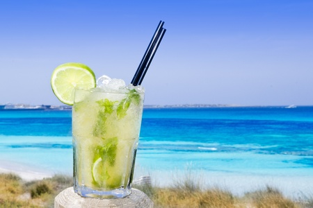 Cocktail mojito ice lemon straws in tropical beach balearic Islands Stock Photo - 9705814