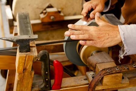 sharpen: grinder traditional wheel hand tools sharpening knife hands
