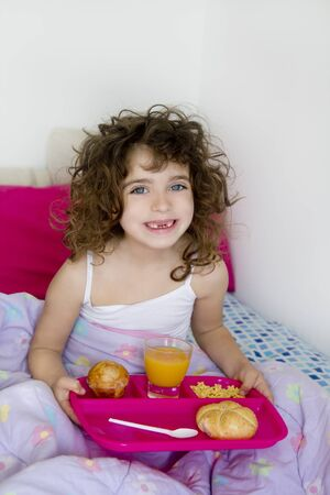 awakening bed breakfast brunette children girl messy hair Stock Photo - 9705807