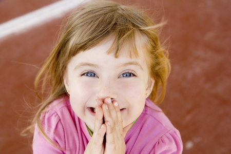 little girl surprised: blond happy smiling little girl excited laugh hands in mouth