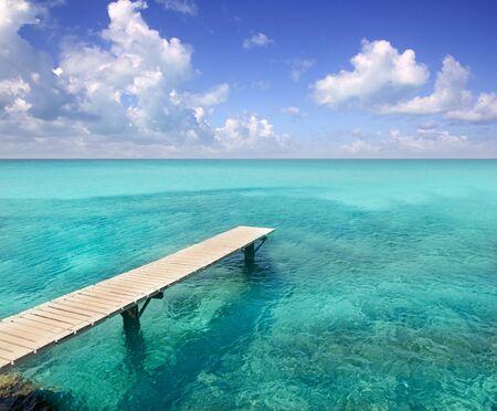 balearic: Illetes illetas beach wooden pier turquoise sea Formentera Balearic islands Mediterranean Stock Photo