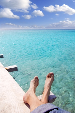 beach turquoise tourist feet relaxed on wood pier tropical sea Stock Photo - 9705815