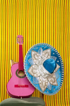 mariachi embroidery mexican hat pink guitar in striped background Stock Photo - 9705929